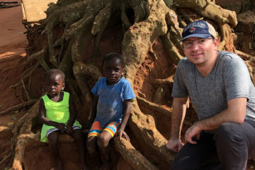 Researcher Umut Gurkan with two children in Ghana, Africa