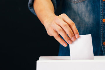 man casts vote at election station