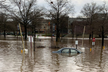 Photo of a car partially submerged in water on MLK Drive in Cleveland
