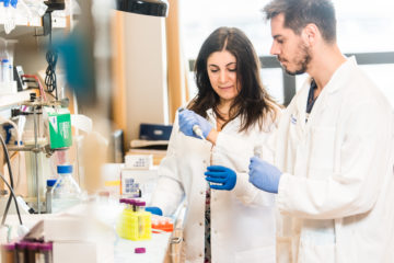 Photo of two researchers in the digestive diseases lab.
