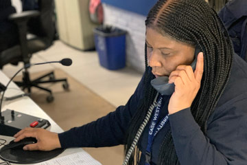 Photo of a CWRU dispatcher on the phone