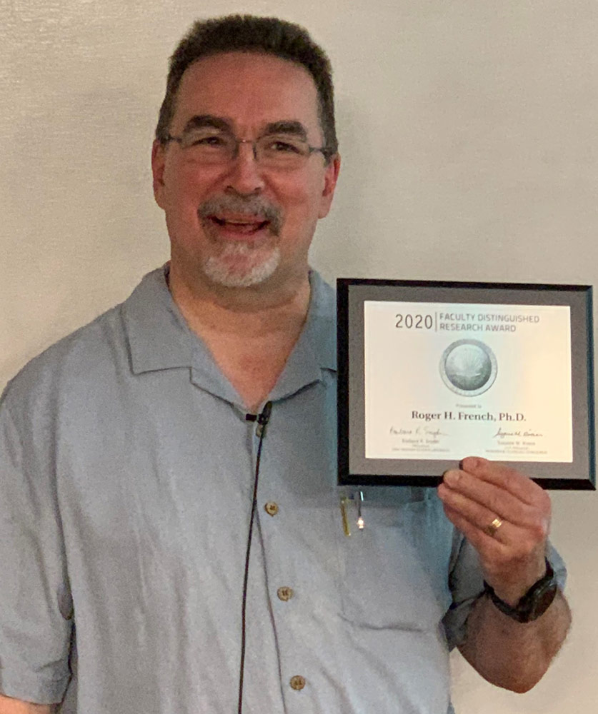 Photo of Roger French holding an award plaque