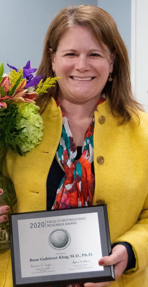 Photo of Rose Gubitosi-Klug holding award plaque