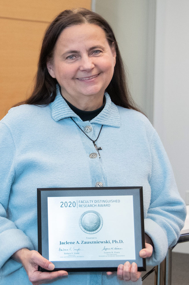 Photo of Jaclene A. Zauszniewski holding an award plaque
