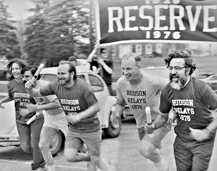 Four Hudson Relays runners with batons in the 1970s