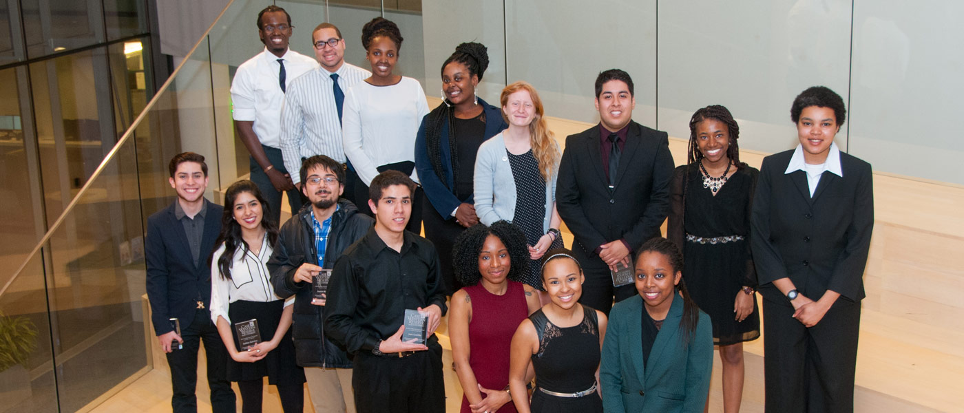 Photo of Unity Banquet award winners posing for photos on grand staircase in Tinkham Veale University Center in 2015