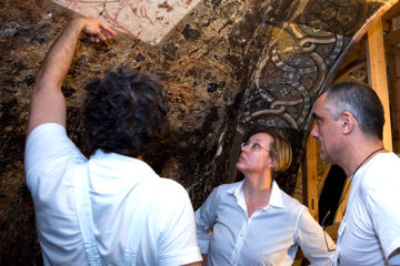 Art history professor Betsy Bolman looks at a wall painting with two others