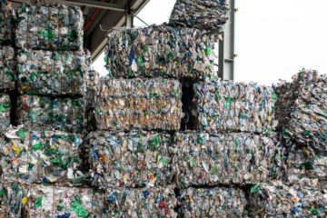 Photo of compressed recycled goods in stacks at a facility