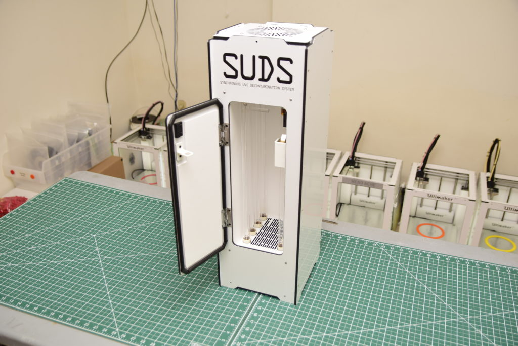 Photo of an N95 respirator disinfecting machine, called SUDS.
