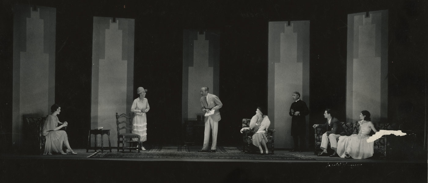 """Black and white photo showing actors on the stage during a 1930 performance of Cleveland Play House's """"The Importance of Being Earnest"""""""