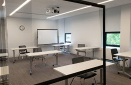 Photo taken of a plexiglas shield to show how to create a barrier between faculty and students in Mandel School classroom