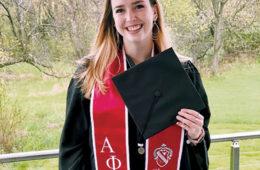 Case Western Reserve 2020 alumna Grace Moran holds her graduation cap in her hand