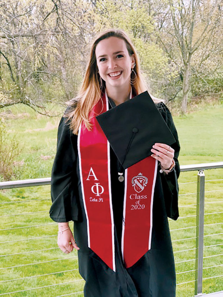 2020 Case Western Reserve alumna Grace Moran holding a graduation cap at her home in Chicago