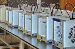 Photo of row of 3d printers at Sears thinkbox