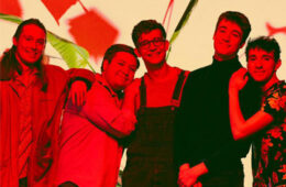 Posed photo of the five members of the music group Spirit of the Bear with a red overlay