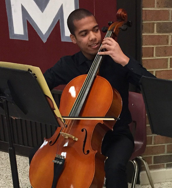 Photo of Micco Daniels playing the cello