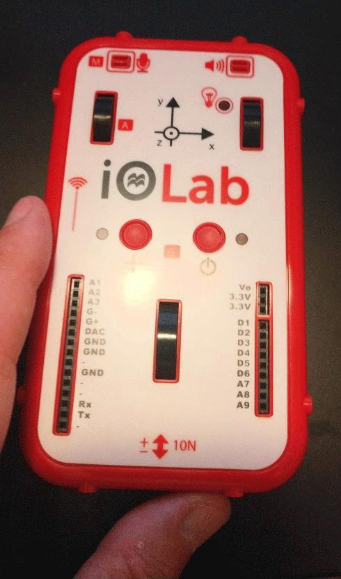 Photo of someone holding a device called an iOLab