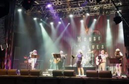 Photo of the Razing the Bar band performing on stage at the House of Blues