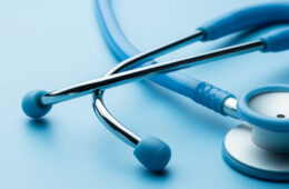 Photo of a stethoscope against a blue background