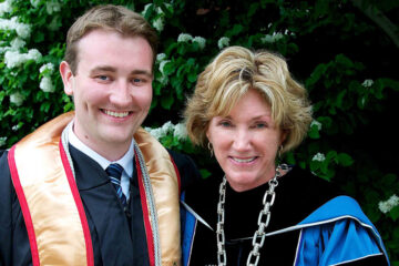 Photo of President Barbara R. Snyder and Christian Wargo in regalia during commencement celebration