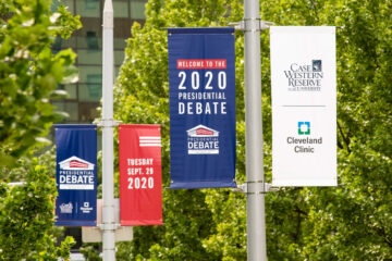 Photo of the signage for the presidential debate with trees in the background