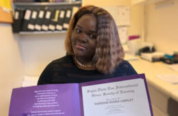 Photo of Marshae Lashley holding a certificate