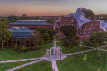 aerial view of the law school, business school and East Bell Commons on the CWRU campus at dusk