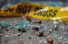 Photo of bullet casings and broken glass at crime scene