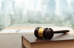 Photo of a gavel on top of a hardcover book