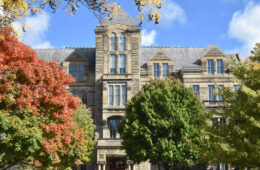 Photo of Adelbert Hall with trees in fall colors