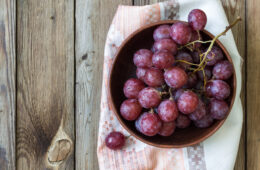 Photo of red grapes in a bowl on a table