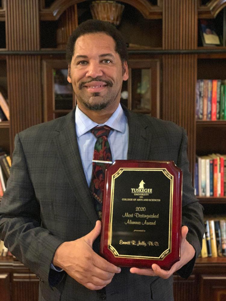 Emmitt Jolly holding a plaque