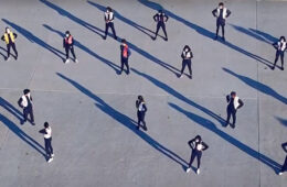Photo taken from above of socially distanced med students performing Doc Opera skit outside