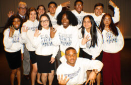 Group of the Posse 4 Scholars posing for a photo and holding up four fingers each