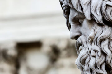 Close up photo on the face of a Zeus sculpture