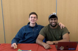 Will Schwartzman and Gautham Chitturu pose for a photo at a tabling event