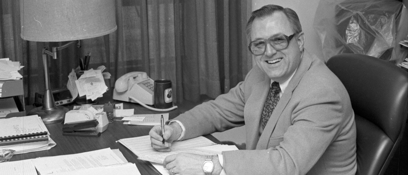 Black and white photo of Don Chenelle at his desk