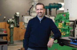 Photo of Michael Goldberg surrounded by equipment at Sears think[box]