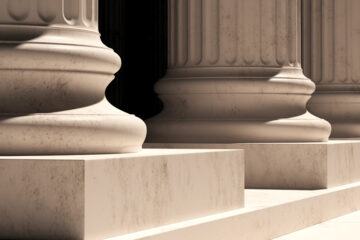 Photo of pillars in front of a courthouse