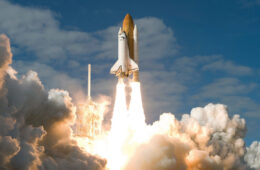 Photo of a space shuttle lifting off